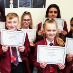 Students with their OSA certificates web